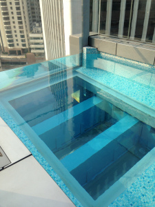 Part of the pool has a glass floor enabling you to float over the skyline.